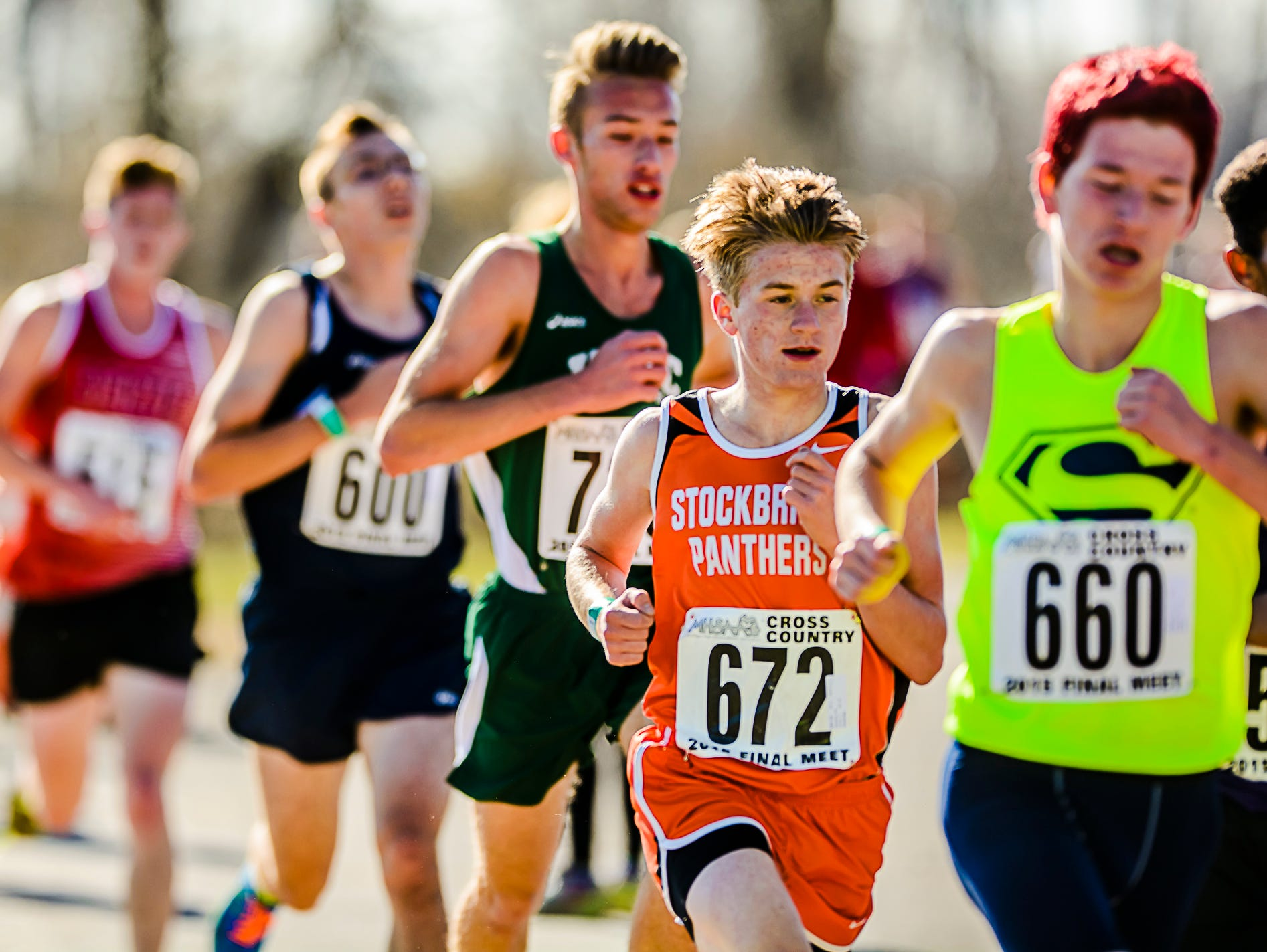Jake Chapman ,672, of Stockbridge runs in the Division 3 championship race Saturday. Chapman would lead the Stockbridge team with an 18th place finish.