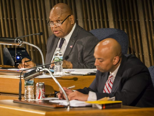 City Council President Theo Gregory speaks as members
