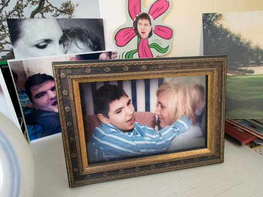 A photo displayed on a shelf of Carson McCord, left, and his sister Alexandria.