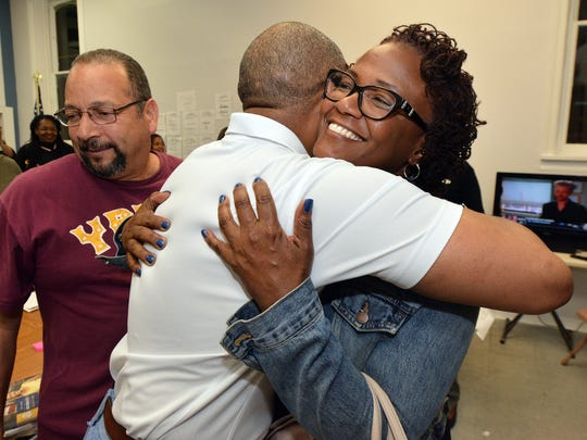Mayor Kim Bracey gets a hug as results show the incumbent defeating challenger Michael Helfrich, Tuesday, May 16, 2017.  John A. Pavoncello photo