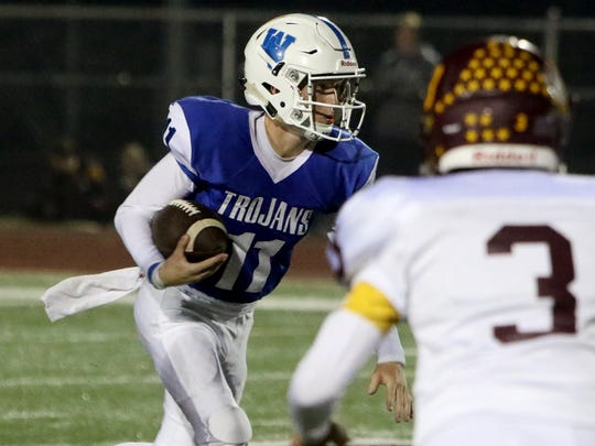 Windthorst quarterback Hunter Wolf keeps the ball and