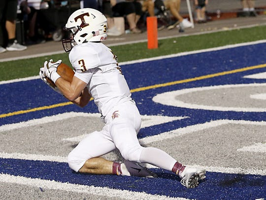 Turpin's Cody Kidd slides into the end zone with a touchdown reception against West Clermont during their 2018 Skyline Chili Crosstown Showdown at West Clermont Friday, Sept. 14, 2018.
