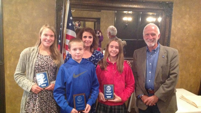 From left to right, students Emily Bender, Nicholas Simonetty and Gabriella Barger along with Rotarians Wendy McNamara and Thom Piliouras.