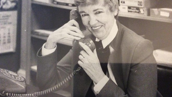 Helen Ackley working at the Kennebunk-Kennebunkport Chamber of Commerce in the 1980s.