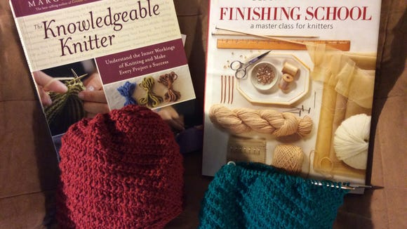 """The Knowledgeable Knitter"" by Margaret Radcliffe and ""Finishing School"" by Deborah Newton are two books that will be awarded to readers tonight by random number generator. And below them are two examples of the hats we'll be knitting Monday night at the Bridgewater library."