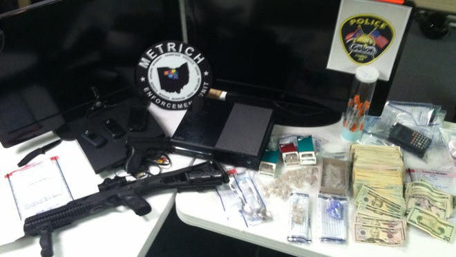 Drugs, weapons, cash and other items were recovered from a residence at 539 S. Boston St. in Galion Thursday morning, following an investigation led by the Galion Police Department. Credit: Galion Police