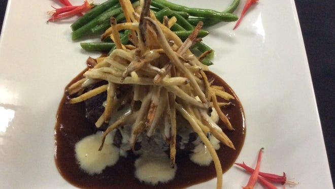 Wylds' Tenderloin Saga features filet mignon, its five-day demi-glace, shoe-string frites and Saga blue cheese.