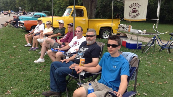 Klassic Haulers (from left) Buck and Sue Sobolewski of Livonia, Randy Bastion of Canton, Bob Mroz of Livonia, Mark Laskosky of South Lyon and Gary Michalak and his son Kevin of South Lyon were among people at Cruisin' Hines.