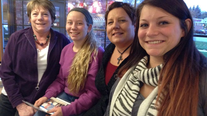 Working on the St. John's Veterans Project with Kendra Schaffer (from left), are her daughter Bethany Schaffer, Jamie Kittle and and her other daughter Anna Schaffer.