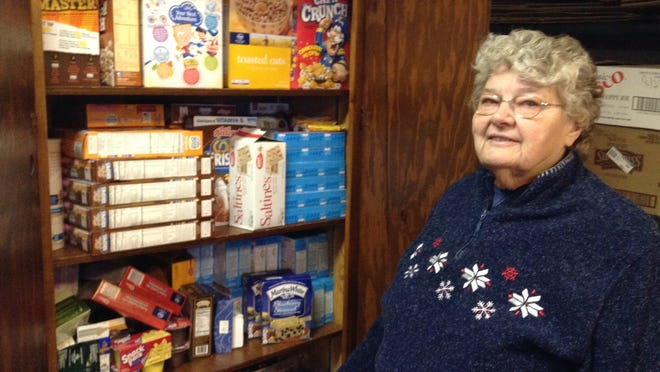 Garden City resident Carol Napier keeps everything neatly organized in the food pantry at Good Hope Lutheran Church in Garden City.