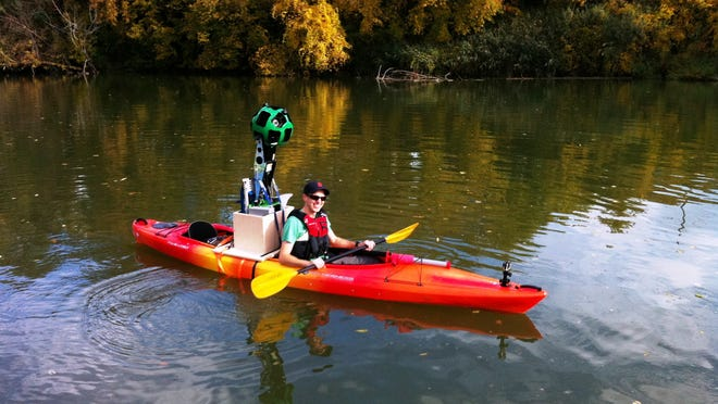 Robert Wilson, of Pure Michigan, prepares to paddle part of the Island Loop National Water Trail with Google's Street View Trekker. The water trail and the Fort Gratiot Light Station County Park are two of 12 Michigan destinations showcased through Street View in Google Maps.