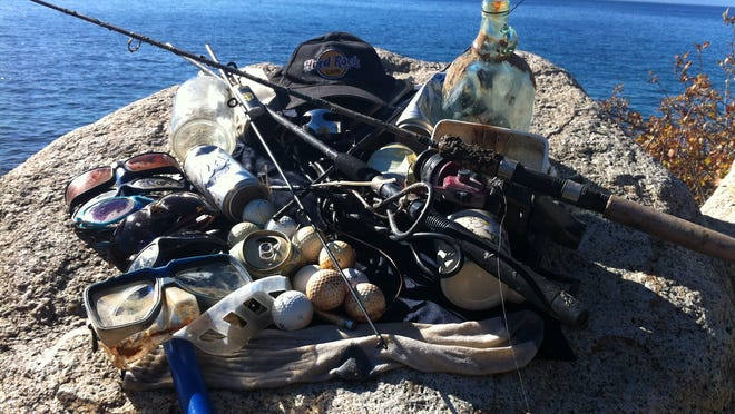 Trash collected during a single dive last summer rests atop a rock on Lake Tahoe's shoreline.