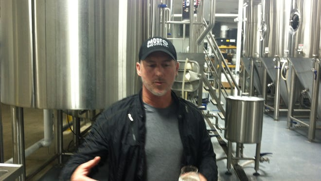 Proof owner Byron Burroughs leads a tour of the new production brewery in Railroad Square.