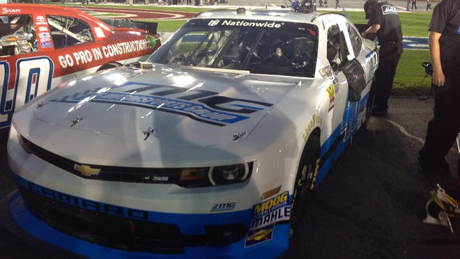 Car No. 40 waits to race at Charlotte on Friday. William Penn High School freshman Brenden Berg designed the car's blue and white exterior.