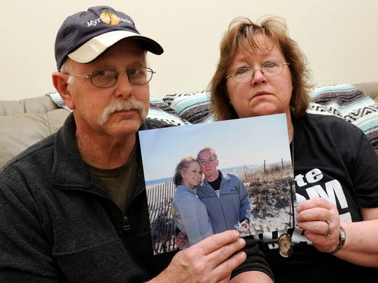 Wayne and Darleen Addis hold a portrait of their daughter, Jenilyn, and her husband, Brandon Franklin, on April 25, 2012. The newlywed couple were killed on Sept. 26, 2006, when their motorcycle was struck by a pickup truck driven by Larry Bruce Williamson, who was convicted of aggravated vehicular homicide.