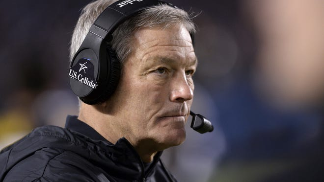 "Iowa coach Kirk Ferentz watches from the sideline during the second half of the team's Holiday Bowl NCAA college football game against Southern California  in San Diego. Iowa football strength and conditioning coach Chris Doyle has been placed on administrative leave after several black former players posted on social media about what they described as systemic racism in the program. Ferentz made the announcement Saturday, June 6, 2020, calling it ""a defining moment"" for Iowa's football program in a video posted on the team's Twitter account."