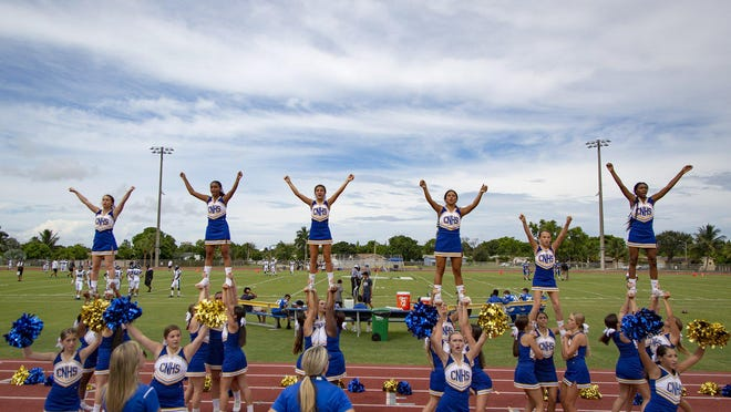 If the start of fall practice is delayed, the start of the high school football season will be pushed back, too, meaning these Cardinal Newman cheerleaders, shown at their season opener in 2019, probably won't be on the field until September.