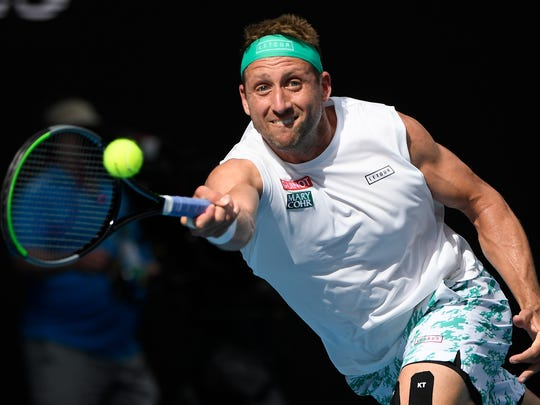 Tennys Sandgren of the U.S. makes a forehand return to Switzerland's Roger Federer during their quarterfinal match at the Australian Open tennis championship in Melbourne, Australia, Tuesday, Jan. 28, 2020. (AP Photo/Andy Brownbill)
