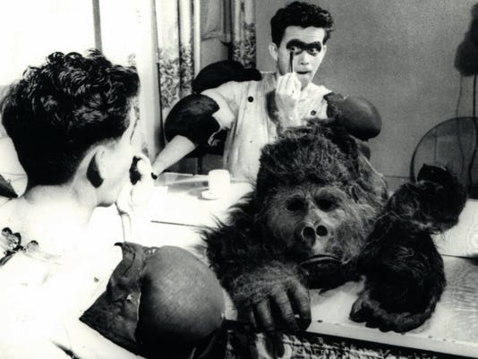 636051466634110414-1.-Publicity-photo-showing-Charlie-preparing-to-put-on-his-gorilla-suit.jpg