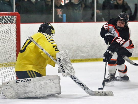 Brighton's Matthew Kahra moves in on Hartland goalie
