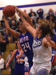 Reno's Kaitlynn Biassou (24) grabs a rebound while