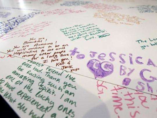 Hand-written messages on poster boards from the funeral service. Jessica's parents refuse to let their daughter's death be forgotten and plan to mount an awareness campaign.