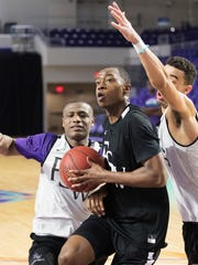 Florida SouthWestern State College's DJ Wilkins scores during practice on Friday at the Suncoast Credit Union Arena in south Fort Myers. FSW will play in the second round of the National Junior College Athletic Association Division 1 Championship Tournament on March 21 in Hutchinson, Kansas.