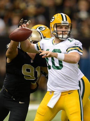 Green Bay Packers quarterback Matt Flynn (10) loses the football while being hit by New Orleans Saints outside linebacker Kasim Edebali (91) in the fourth quarter during Sunday night's game at the Superdome in New Orleans. The Saints recovered the ball on the play. Evan Siegle/Press-Gazette Media