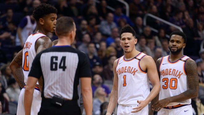 Dec 26, 2017: Phoenix Suns guard Devin Booker (1 )argues with referee Justin Van Duyne (64) fouling out against the Memphis Grizzlies during the second half at Talking Stick Resort Arena.