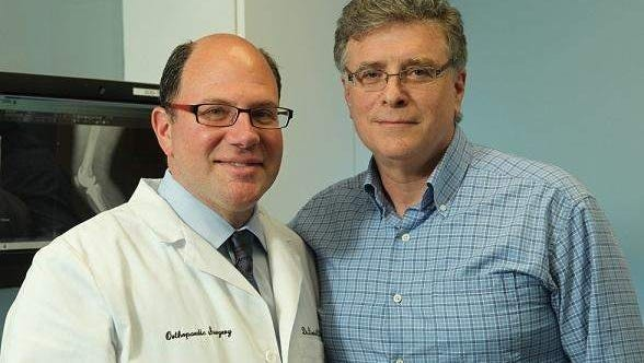 David L. Chalnick, M.D., a fellowship-trained, board-certified orthopaedic surgeon and Medical Director of The Joint Replacement Center at MMC pictured with Long Branch resident Ira Gerstler