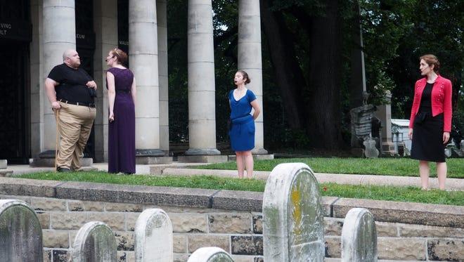 The cast of 'Richard III' rehearses a scene at  Laurel Hill Cemetery. From left are Ryan Walter, Neena Boyle, Megan Edelman, and Loretta Vasile.