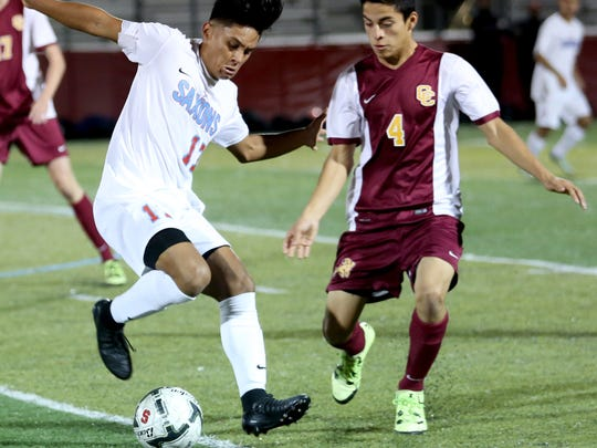 South Salem's Sebastian Ruelas (17) and Central Catholic's Tajo Fischer (4) fight for the ball in the Central Catholic vs. South Salem boy's soccer game in the second round of 6A playoffs at South Salem High School on Wednesday, Nov. 2, 2016. Central Catholic won the game 9-8 after 11 rounds of penalty kicks.