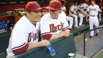Arizona Diamondbacks pitchers David Hernandez (left) and Archie Bradley laugh before playing against the San Francisco Giants at Chase Field in Phoenix on April 6, 2015.