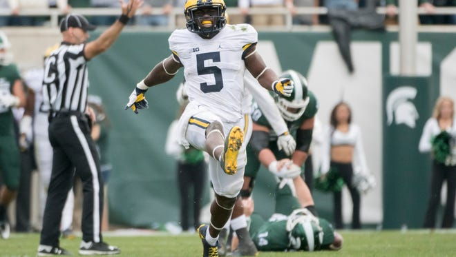 Michigan safety Jabrill Peppers celebrates after sacking Michigan State quarterback Brian Lewerke late in the fourth quarter.