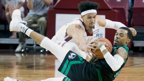 New Mexico State's Eli Chuha, top, and the Aggies host Seattle Saturday night at the Pan American Center.