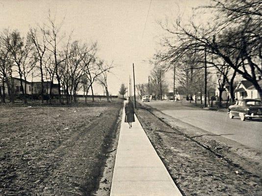 Mrs. Esther Lyle on new sidewalk November 1954 (2).jpg