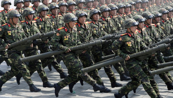 Women soldiers march across Kim Il Sung Square during a military parade on in Pyongyang, April 15, 2017, They were celebrating the 105th birth anniversary of Kim Il Sung, the country's late founder and grandfather of current ruler Kim Jong Un.
