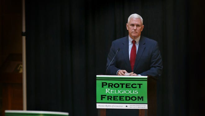Indiana Gov. Mike Pence speaks to supporters of religious liberty legislation in Indianapolis on Monday, Feb. 9, 2015. On Thursday, March 26, 2015, Pence signed the bill into law.