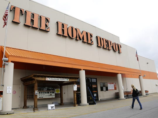 A customer walks toward a Home Depot in Nashville, Tenn. Home Depot Inc., the nation's largest home-improvement retailer, on Tuesday, Feb. 10, 2015 said it has started to hire more than 80,000 seasonal workers for the spring selling season, the company's busiest period.