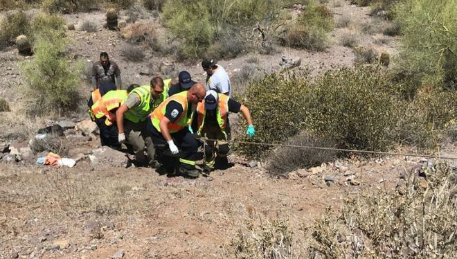 Superstition Fire and Medical District crews assist a motorcycle rider on June 17, 2018.