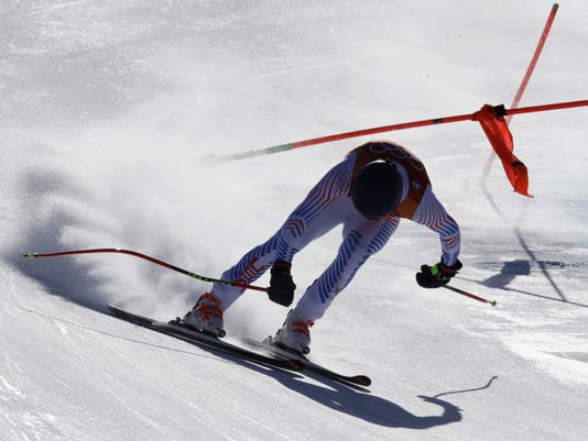 United States' RyanCochran-Siegle loses control just before crashing during the downhill portion of the men's combined at the 2018 Winter Olympics in Jeongseon, South Korea, Tuesday, Feb. 13, 2018. (AP Photo/Luca Bruno)