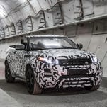 Land Rover confirmed it will make a convertible version of the Evoque next year, but show an image clad in camo.