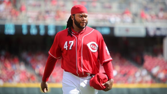 Reds ace Johnny Cueto walks off the mound on Sept.