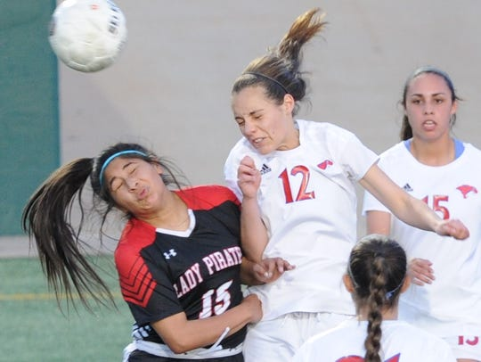 Abilene Cooper's Jenna Morris (12) battles Lubbock Cooper's Dakota Moreno (15) for the ball in a District 4-5A soccer game March 6 at Shotwell Stadium. Morris signed on Monday to play soccer at Cisco College.