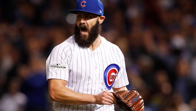 Oct 18, 2017; Chicago, IL, USA; Chicago Cubs starting pitcher Jake Arrieta (49) reacts after striking out Los Angeles Dodgers outfielder Curtis Granderson.