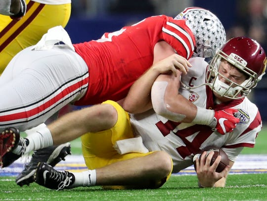 Dec. 29, 2017; Arlington, TX, USA:  Ohio State defensive end Sam Hubbard (6) sacks USC quarterback Sam Darnold (14) during the 2017 Cotton Bowl at AT&T Stadium. Ohio State won 24-7.