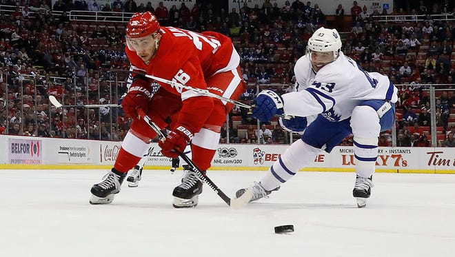 Detroit Red Wings right wing Tomas Jurco (26) collects the puck ahead of Toronto Maple Leafs center Nazem Kadri on Wednesday, Jan. 25, 2017, in Detroit.