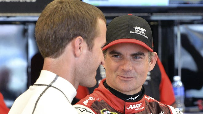 Jeff Gordon, right, talks with Kasey Kahne Friday. Gordon has won at every current track on the circuit, except for the Kentucky Speedway.