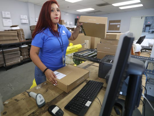 Boxzooka Warehouse Supervisor, Geraldina Vadillo, works in the Secaucus packaging department,  Tuesday, July 24, 2018.
