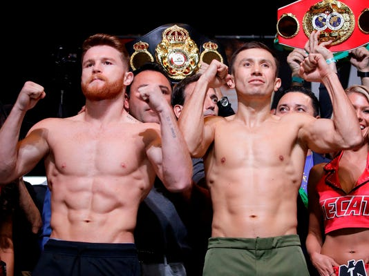 FILE - In this Sept. 15, 2017, file photo, Canelo Alvarez, left, and Gennady Golovkin pose during a weigh-in in Las Vegas. Alvarez has withdrawn from his planned middleweight title fight with Golovkin, the latest result from Alvarez testing for a banned substance. The fight on May 5 in Las Vegas was to be a rematch of the draw they fought last September. (AP Photo/John Locher, File)